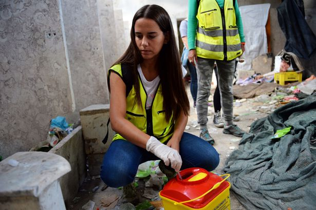 maria-carmona-heads-the-lisbon-outreach-team-clearing-drug-paraphenalia-in-a-problematic-suberb1