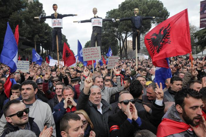 Supporters of the opposition Democratic Party take part in an anti-government protest in front of the office of Albanian Prime Minister Edi Rama in Tirana