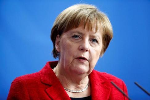 German Chancellor Merkel attends news conference after talks in Berlin