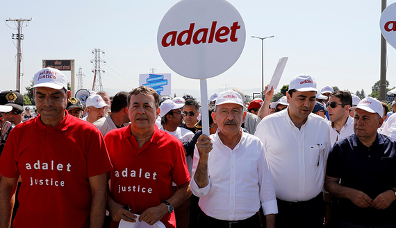 "Turkey's main opposition Republican People's Party leader Kemal Kilicdaroglu and Secretay General of the Socialist International Luis Ayala walk flanked by supporters during the 14th day of a protest dubbed ""justice march"" in Duzce"