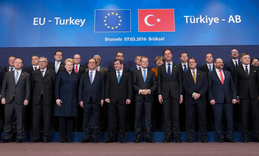 Turkish Prime Minister Ahmet Davutoglu poses with European Union leaders during a EU-Turkey summit in Brussels